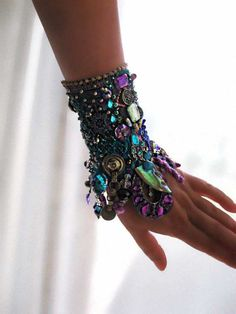Cool Mystique Gypsy Jangle Bracelet, Heavily Beaded, Jeweled, Purple, Blue, Green, Black, Silver, Bohemian. $275.00, via Etsy.