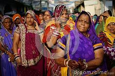 Group of Indian women wearing colourful, traditional sari on streets of Pushkar, Rajasthan, India