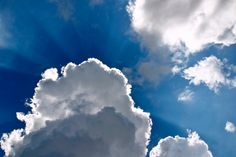 Picture of a blue sky with white clouds. Corona of sunrays behind the center cloud. IT Technology. Close Up, Holland, Clouds, Sky, Canvas, Nature, Prints, Outdoor, Halo Poster