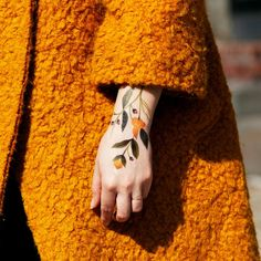 A bold new floral by tattoo artist Jess Chen is based on her real eye-catching, body-framing tattoos.