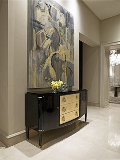 gorgeous foyer....large scale artwork and glamorous credenza add elegance and drama at the same time.