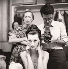 Richard Avedon shooting Dovima with Rolleiflex as Diana Vreeland looks on.