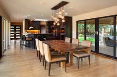 wood slab dining table Dining Room Contemporary with ceiling lighting chandelier dining Wood Slab Dining Table, Dining Table Lighting, Dining Room Light Fixtures, Dining Table Design, Dining Room Table, Kitchen Lighting, Dining Area, Wood Tables, Trestle Table