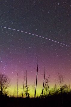 ...a different angle on the aurora and the International Space Station, captured by Brian Larmay of Beecher, Wis. The long streak in this time-lapse photograph is the space station, sailing across the sky. #aurora