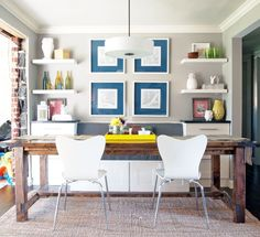 I like the rustic table with the modern chairs. The main pieces of the room are pretty neutral, but there are good pops of color in the accessories.