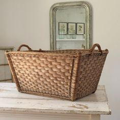 "French vintage wicker basket.  28"" L x 19 1/2"" W x 13 1/2"" H"