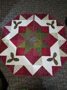 """This is my version of a Christmas Tree skirt pattern from Craftsy. It is 56"""" wide. The blocks are 7"""" squares and 7"""" half square trangles (finished). I thought it would be too big but it was perfect for my tree! The fabric was Kim Diehl from Henry Glass."""