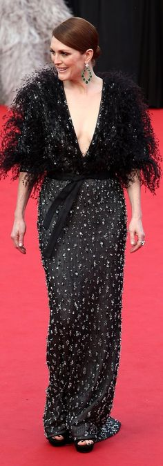 Julianne Moore accessorized her feather and sequin dress at Cannes Film Festival with emerald hoop earrings.