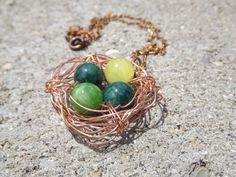 Copper bird's nest necklace- varied green beads