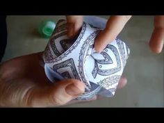 Learn how to make these beautiful and decorative paper balls with this video tutorial. Find out more at http://hattifant.com/triskele-paper-globes/