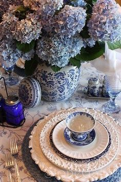 Hydrangea Hill Cottage  blue and white table setting with blue glass and hydrangeas