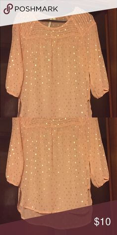 Shirt never worn $10 pinkish/peach with gold dots Pinkish/peach color with gold dots never worn Tops Blouses