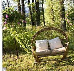 wicker furniture placed around the yard- pictures on the loveseat of all the guests?