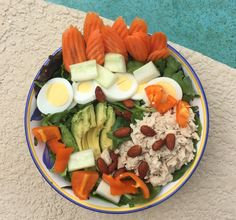 Salad: Spinach and Baby Kale, Balsamic, Carrots, Cucumbers, Peppers, Tuna, Avocado, Egg, Almonds