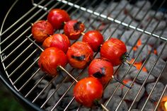 A bright favorite of summer, cherry tomatoes get the fire treatment here. Instead of being served plain or as part of a salad, they are tossed with salt and pepper and skewered and grilled until slightly soft and a bit blistered. (Photo: Andrew Scrivani for The New York Times)