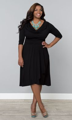 Feel fabulous and flirty in our plus size Draped in Class Dress.  A fluid draped neck and faux wrap skirt add detail and shape to this fun and refined style.  #MadeintheUSA  #Kiyonna