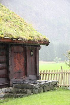 Cabin with a beautiful door and sod roof