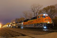 Northbound BNSF Empty Coal Train at Kansas City, MO - A new SD70ACe heads up BNSF Train E PAMETM0 101, a coal empty tied down at 30th Street on the BNSF Ft. Scott Sub. on Main Track 1.   Locomotives: BNSF 8550, BNSF 9660, BNSF 9982, BNSF 9828   11-26-14 Kansas City, MO