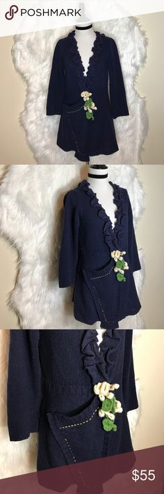 """Anthropologie Field Flower Daisy-Duo Navy Cardigan This cute cardi has been gently preloved, It's 66% lambs wool, 17% nylon, 13% wool, & 4% cashmere.  It has one big pocket on the right side, & it closes with two snaps under the flowers. Ruffles on the neck contrast the stitching around pocket. Laid flat across @ bust: 18"""", length: 27"""". The only minor are some spots of balling of the fabric but it never been worn. NWOT Anthropologie Sweaters"""