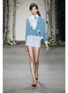 Blue satin canvas jacket over silk blouse and peplum shorts with flowerbed embroidered lace trim from HONOR's Spring 2014 Collection.