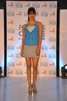 Priyanka Chopra made us drool in an Anand Bhushan Superman top and nude mini skirt at a presser to launch the People's Choice Awards 2012 at Hotel ITC Grand Maratha in Andheri, Mumbai on Thursday, October 18.