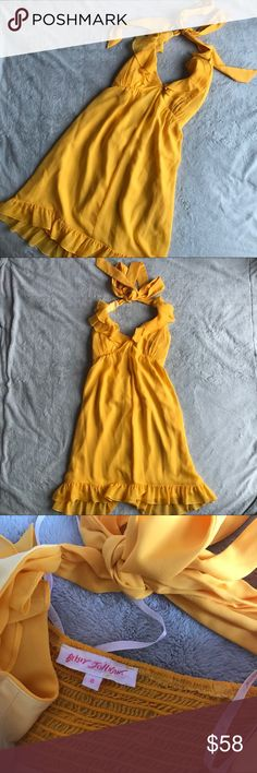 Betsey Johnson Yellow Silk Chiffon Ruffle Dress Great used condition. Silk chiffon cocktail dress by Betsey Johnson in stunning vibrant yellow (almost orange), perfect for spring and summer. Ruffle neckline and flouncy bottom hem with halter tie and smocked back. Hidden side zipper. Lined. 100% silk. Made in USA. Note: a couple light spots on front of dress & loose thread at neck tie, see photos. Size 8, see photos for measurements. Betsey Johnson Dresses