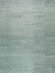 New Moon Rug - Ornament 10, cool rain. This subtle and sophisticated dot pattern uses a unique dyeing technique to create a background with lots of variation and abrash. This pieces utilizes a teal blue green Tibetan wool background with dots in creamy Chinese silk.