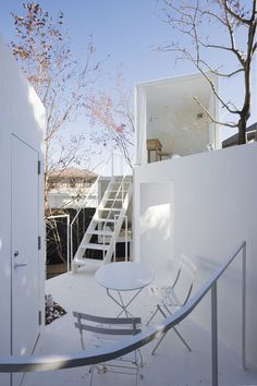 """House before House"" • Utsunomiya, Japan • Sou Fujimoto Architects. ""Nine white cubes are stacked together to form a cluster of rooms around a small courtyard. Some of the exterior staircases lead to the interior spaces of these boxes, while others lead to the terraces on top of the boxes."""
