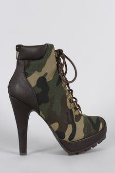 """Anne Michelle Camouflage Military Lace Up Lug Sole Platform Heeled Booties. Description These modern attitude camouflage  lug sole . Designed with a rear back zipper for easy on-off wear. Finished on a leg-lengthening platform and chunky heel.Material: Fabric and Vegan Leather (man-made)Sole: Waffle Synthetic  Measurement Heel Height: 5"""" w/ 1.3"""" Platform (approx)Shaft Length: 9.6"""" (including heel)Top Opening Circumference: 8"""" (approx)Fitting Tips:Foot Model is a true size 6, foot measures…"""