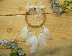 Super girly and sweet car dreamcatcher - with ribbon bow and white feathers. The perfect size for your car or window!