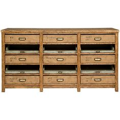 Made from solid oak with an antiquarian finish, this beautiful piece adds a vintage touch to any room of the house. Alternating rows of burlap-wrapped drawers and sliding metal trays store your essential accessories or supplies.