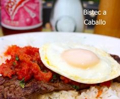 Bistec a caballo - Skirt steak, an egg, and some salsa with some patacones. This is a quick family friendly meal particularly if you have a hungry man you want to please. Colombian Dishes, My Colombian Recipes, Colombian Food, Cuban Recipes, Fun Easy Recipes, Easy Meals, Kitchen Recipes, Cooking Recipes, Spanish Dishes