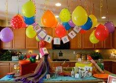 Balloons and decorations for a Rainbow Art Party #rainbow #artparty (love how they hang the balloons upside down!)