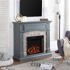 A faux stone frame surrounds the brick interior of the Southern Enterprises Seneca Infrared Electric Fireplace – Gray for a rustic, lodge-inspired. Electric Fireplace With Storage, Media Electric Fireplace, Media Fireplace, Fireplace Mantels, Fireplace Ideas, Faux Fireplace, Fireplace Design, Brick Fireplace Remodel, Fireplace Makeovers