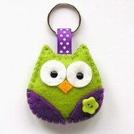 This cute little owl key ring is designed and hand sewn by me using felt. She has colourful wings which have a coordinating flower button sewn on and she is lightly padded with polyester filling Other colours available upon request :)