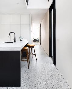 A black and white kitchen with matt polished concrete floors Photography by Emily Bartlett Polished Concrete Kitchen, Concrete Kitchen Floor, White Kitchen Floor, Polished Concrete Flooring, Terrazzo Flooring, White Concrete, Kitchen Flooring, White Flooring, Neutral Kitchen