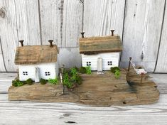 Original Driftwood Art by ontheTides These lovely little houses have been made using reclaimed wood and driftwood. They both have been painted in white chalk paint and slightly distressed to give a shabby feel to them. Their window frames have been painted in pale winter grey with black