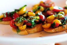 """This Bruschetta is absolutely delicious. The best tip is to """"fry"""" the bread in butter. Could have only been better with garden fresh tomatoes and fresh picked basil, can not wait for summer. Recipe from The Pioneer Woman (best food blog ever!)."""