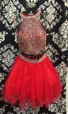 Set the trend in this sassy two piece cocktail featuring a sleeveless top adorned with sequins and AB crystals and a matching tulle skirt crowned with coordinating beadwork.  Exclusive Crown to Heels Dress.  Side zipper closure. Available in Champagne and Cherry.