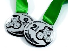 Sport medals with plexiglass transparent and laminate engraving. Medals sided for cyclists.