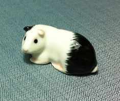 This cute miniature guinea pig was hand painted.  It is very realistic.  This figurine is not vintage and not signed but it will be a perfect