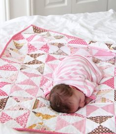 Baby quilt - hourglass pattern, backed with a minkee fabric. It has a really nice weight to it and is super soft (by Shannon Fabrics). Quilted with minimal straight lines here and there to keep it from being too stiff.