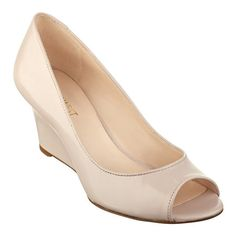 """As seen in the February issue of Women's Day, meet your new go-to shoes for the office. Our Relaxinn peep-toe wedge heels have padded footbeds for all-day comfort. Leather or man-made upper - simply mouse over color swatch for upper material. Man-made lining and sole. Imported. 2 1/2"""" wedge heel. Women's shoes. Peep-toe wedge heels and pumps."""