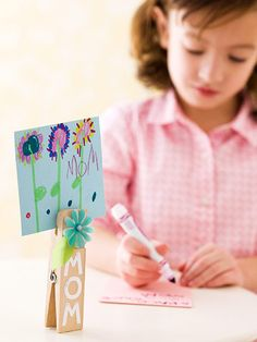 Clothespin Easel: Mom won't miss this display! Embellish an oversize wooden clothespin with scrapbook supplies, then pin up your child's artwork for all to see.