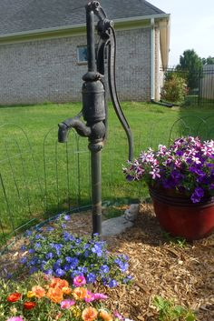 old water pump in flower bed