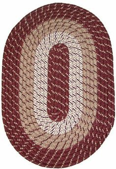Plymouth 8' x 8' Round Braided Rug in Burgundy by Constitution Rugs LLC. $178.99. Rugged Tubular Braid Construction. Manufactured 100% in the U.S.A. 100% Nylon BCF surface yarns. Reversible for added wear. Stitched with Polyester sewing thread. Banded premium tubular braided rug enhances both contemporary and traditional room decors