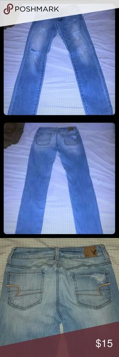American Eagle Jeans Size 0 Regular American Eagle Outfitters light washed jeans  Size 0 Regular size runs a lil big bc of stretch I'm a size 2 and they fit so anything from (0-2)  Distressed  Great condition! Jegging (look & fit more like a straight legged pair of jeans) they're loose fit around the ankles. Materials:  79% cotton, 20% polyester, 1% elastane American Eagle Outfitters Jeans Straight Leg