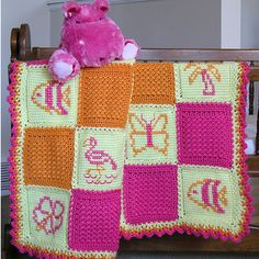 Caribbean Twins Girl Afghan - Bring back fun memories of the Caribbean with this brightly-colored baby afghan. Charts are included to cross-stitch the fish, butterflies, flowers, palm trees and flamingos on the tunisian/afghan stitch squares. This pattern is included in the Caribbean Twins Baby Afghans pattern. Skill level: Easy.
