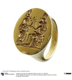 Signet Ring: Queen seated in front of Amun :       Historical Dating: Amanishakheto     Sudan (country)  Meroe (Location)  Pyramid N6 (district)    gold