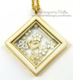 South hill designs gold diamond locket full or flowers, pearls and a delicate butterfly. Shop for yours at www.southhilldesigns.com/leahdawn